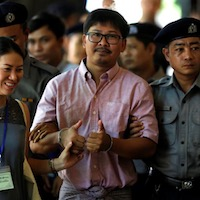 Policeman denies planting documents on Reuters reporters